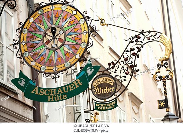 Low angle view of shop sign, Getreidegasse, Salzberg, Austria