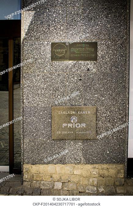 Memorial plaque Ingstav Brno and foundation stone of shopping centre Prior, logo, Masaryk Square in Jihlava, Czech Republic, April 19, 2014