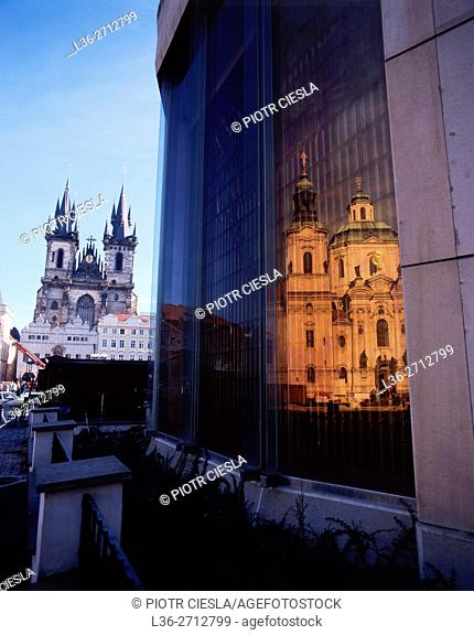 Prague. Old Town Square. The Church of Our lady Before the Tyn and a reflection of St. Nikolaus Church
