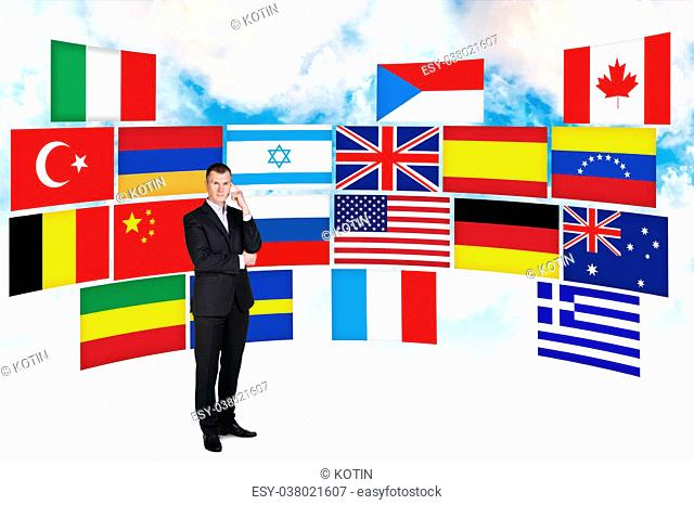 Businessman stands on the many different countries flags background
