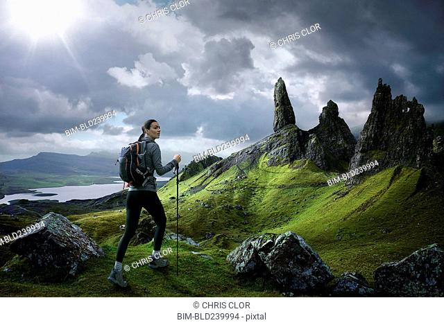 Caucasian woman hiking in rocky landscape