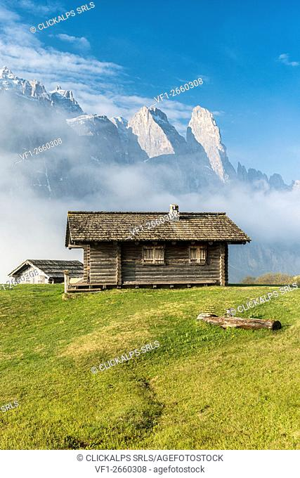 Passo Gardena, Dolomites, South Tyrol, Italy. Mountain hut in front of the mountains of the Sella group