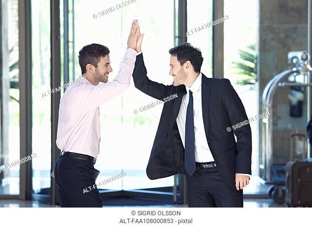 Businessmen celebrating success
