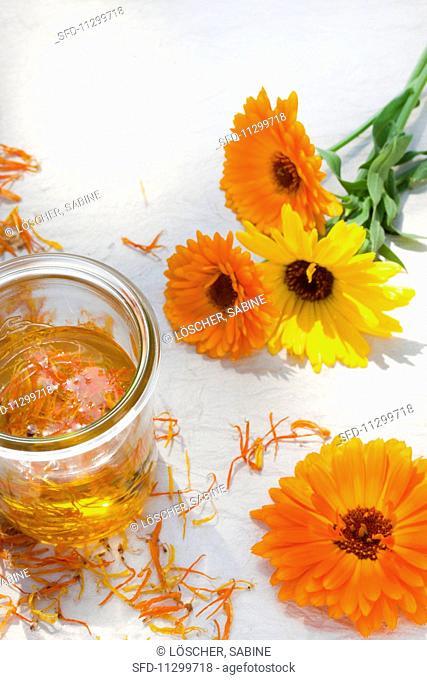 Marigolds (calendula officinalis), dried petals and marigold oil