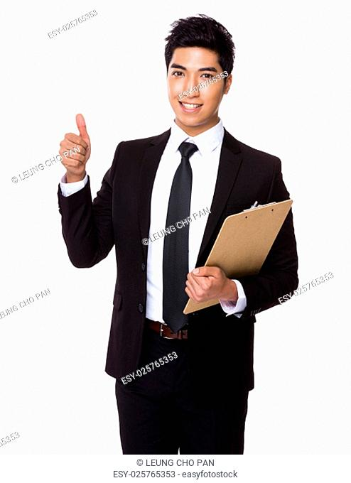 Businessman with clipboard and thumb up