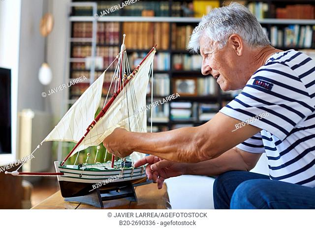 Senior man, 60-70, Building model sailboat, Whaleship, Getaria, Gipuzkoa, Basque Country, Spain, Europe