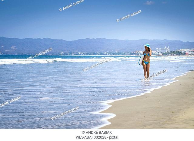 Mexico, Nuevo Vallarta, teenage girl walking at the beach