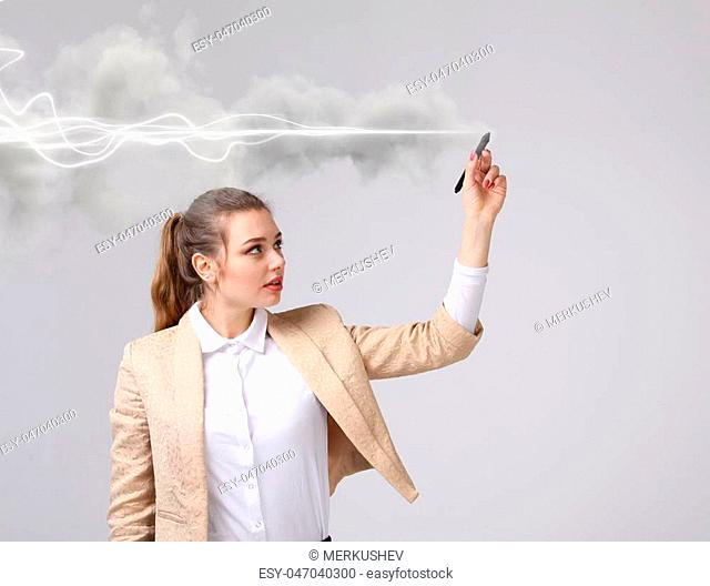 Young woman with pen or stylus making magic effect - flash lightning. The concept of copywriting or writing