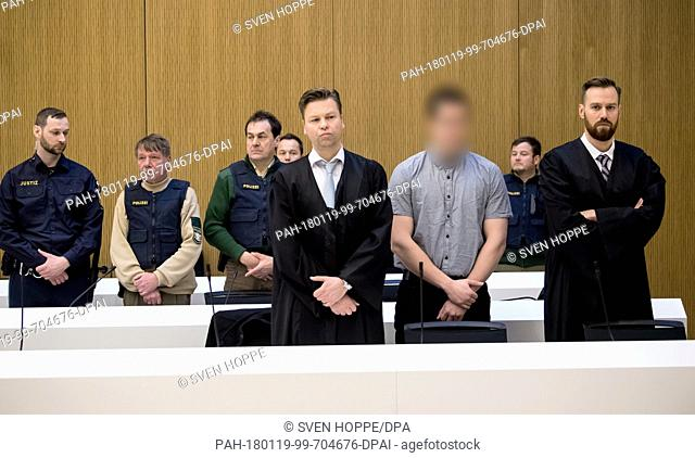 Defendant Philipp K. (c) and his lawyers David Muehlberger (r) and Sascha Marks stand in court for the trial of the alleged weapons dealer of the Munich shooter...