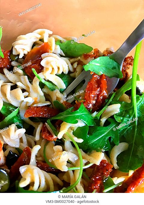 Salad made of pasta, dried tomatoes and vegetables