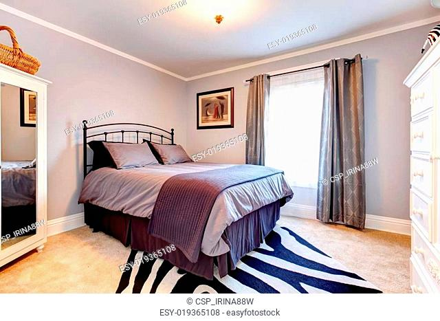 Lavender Bedroom With White Clothes Cupboards