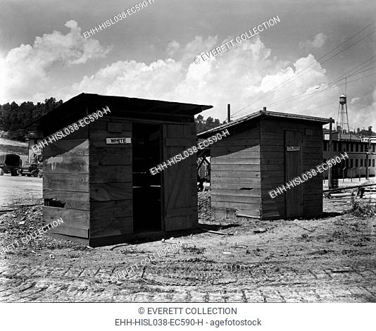 Separate But Equal privies for the construction workers at Clinton Engineer Works, 1943. Construction workers were building the X-10 facility in Oak Ridge