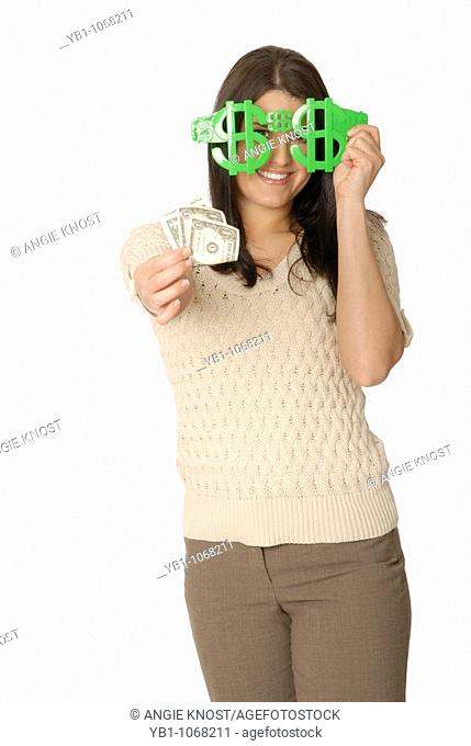 Attractive woman with funny dollar sign glasses and money