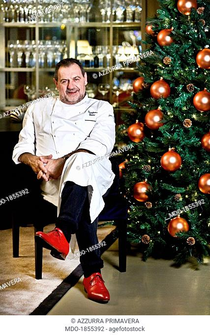 Italian chef Gianfranco Vissani sitting beside a Christmas tree for a photocall shooted at his restaurant. Terni (Italy), 29th November 2013