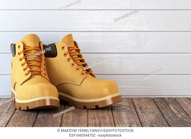 Yellow boots on a wooden table. 3d illustration