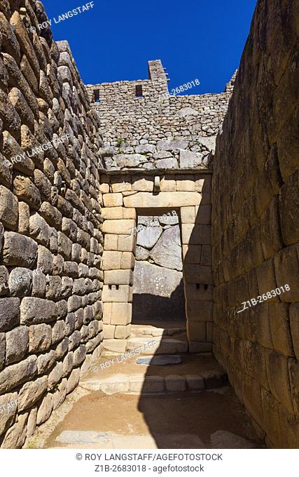 Trapezoidal entry doorway to buildings at Machu Picchu, Peru