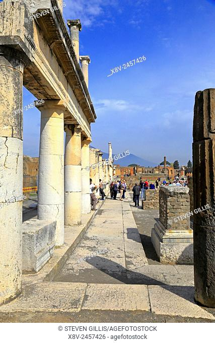 Forum colonnade by the Temple of Apollo with Mount Vesuvius in the distance, Pompeii, Italy