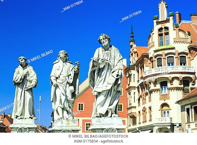 Marble figures. The Plague Column at Main Square (Travni Trg). Maribor. Lower Styria region. Slovenia, Europe