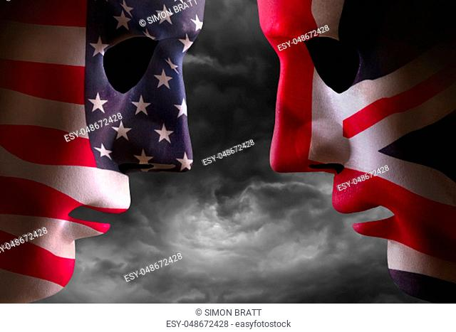 Head to head USA and UK faces with flag textures over the faces. Stormy clouds background