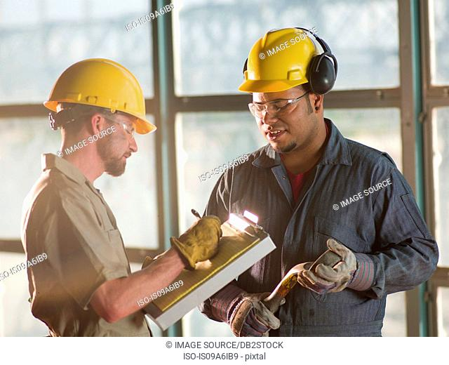 Engineers talking on construction site
