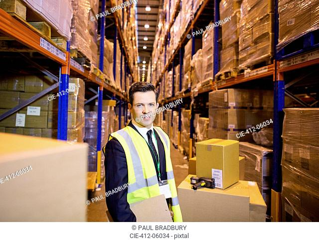 Businessman standing in warehouse