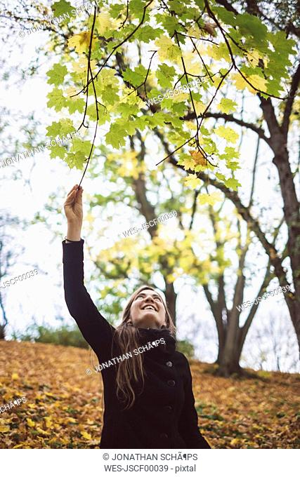 Happy young woman in autumnal forest
