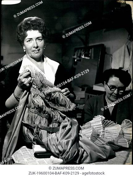 Feb. 24, 1952 - Wardobe Mistress Miss Gerrie Stelzel, Viennese-born, mending one of the 10,000 costumes for which she and her staff are responsible