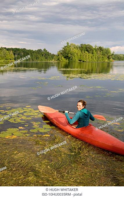 Woman canoeing on lake