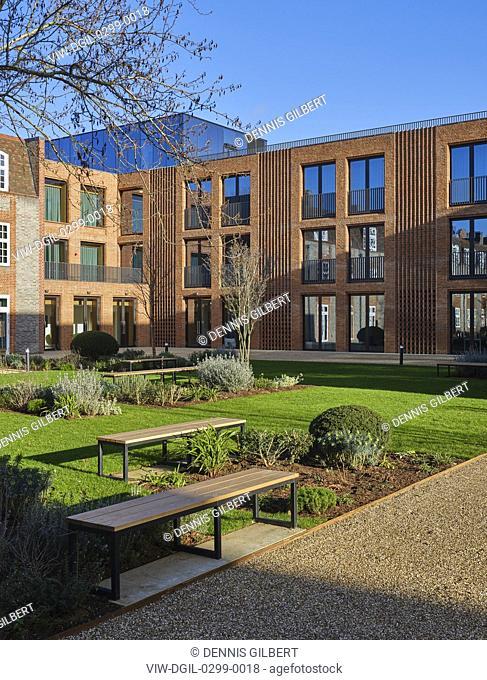 Sunlit facade with landscaped garden - winter view. Newnham College, Cambridge, Cambridge, United Kingdom. Architect: Walters and Cohen Ltd, 2018