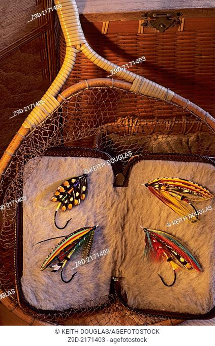 Flyfishing still life of antique net with atlantic salmon flies