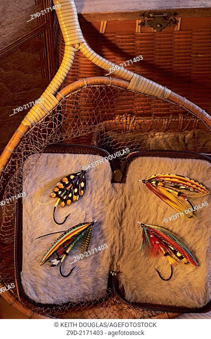 Flyfishing still life of antique net with atlantic salmon flies