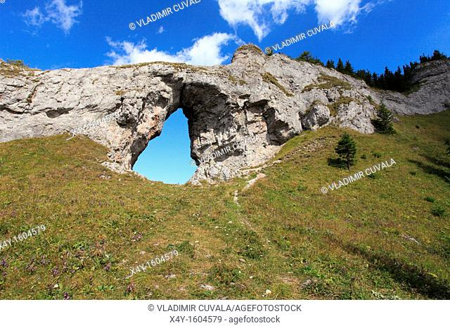 The rock arch 'Okno' at the natural reserve Ohniste, Janska dolina in Nizke Tatry mountains, Slovakia