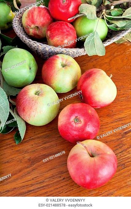 fresh summer apples on wooden table
