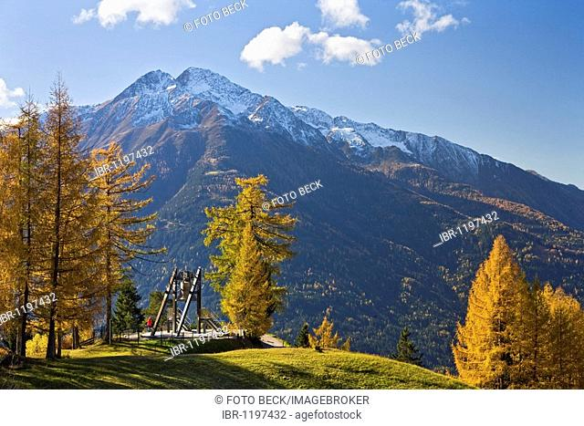 Friedensglocke, Peace Bell, in Moesern, larch trees in autumn, Hocheder in the Stubai Alps, Inntal valley, Telfs, Tyrol, Austria, Europe