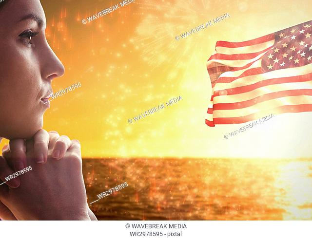 Woman thinking against sea and american flag