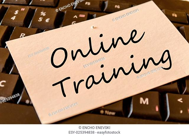 Online training Concept on black keyboard