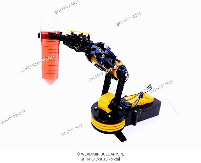 Robotic arm holding beaker against a white background