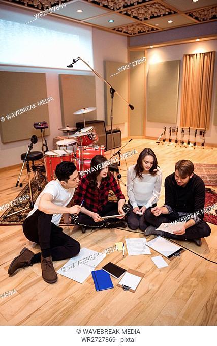 Team of musician composing tune in studio