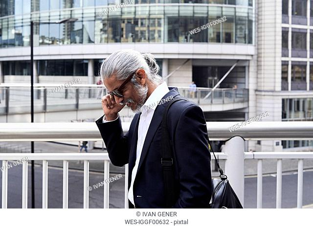 Grey-haired senior businessman talking on the phone