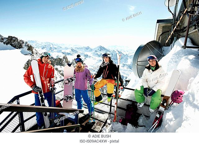 Group of skiers on ski lift stairs
