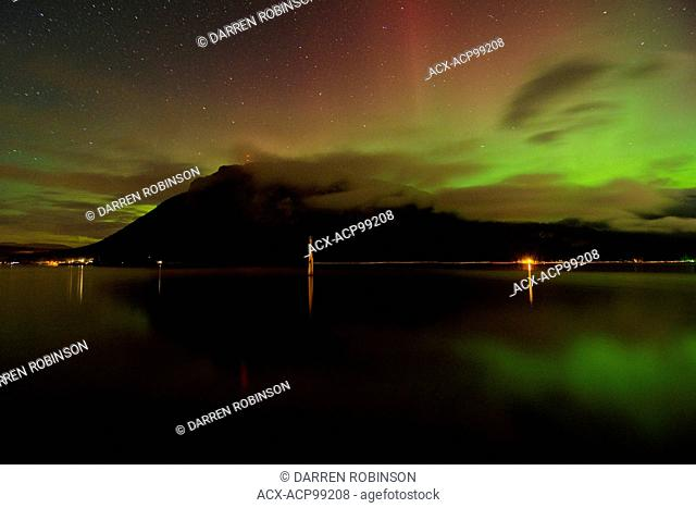 Aurora Borealis as it dances over Bastion Mountain and Shuswap Lake from Canoe Beach, near Salmon Arm in the Shuswap region of British Columbia, Canada