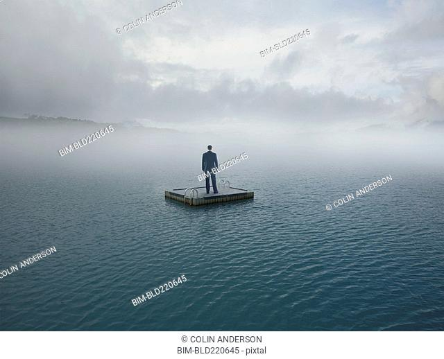 Man floating on dock in remote lake