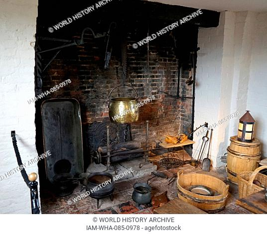 Elizabethan kitchen with fireplace and pots, at Blakesley Hall is a Tudor hall on Blakesley Road, Yardley, Birmingham, England. It dates to 1590
