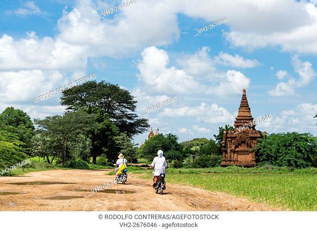 Tourists riding around Bagan temples, Myanmar