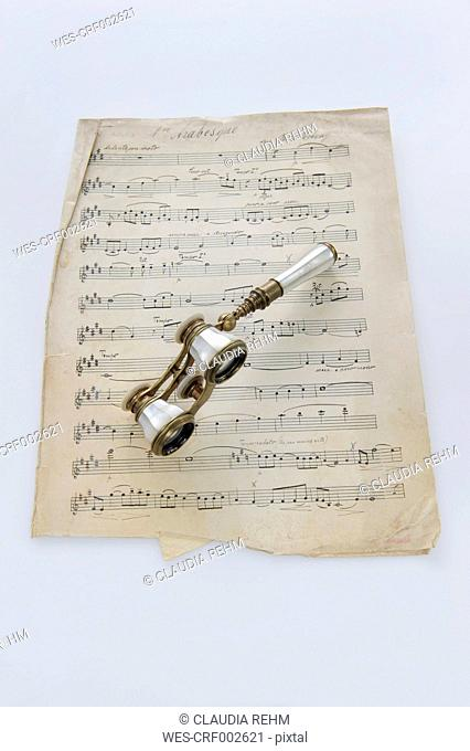 Classical sheet music with opera glass