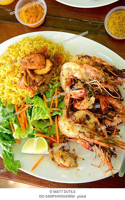 Plate of seafood, rice and salad