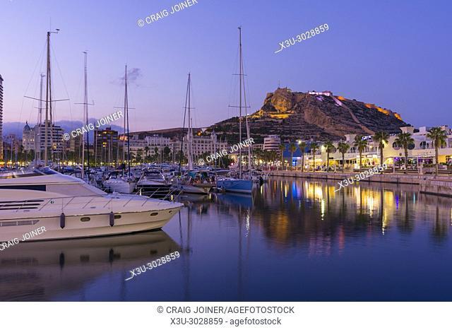 The marina at Alicante at dusk with Santa Barbara Castle beyond, Spain