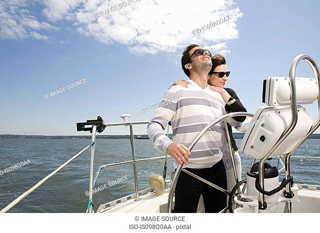 Couple sailing a yacht