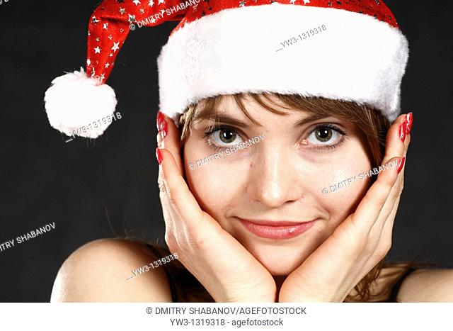 Close-up portrait of a woman wearing a Christmas hat