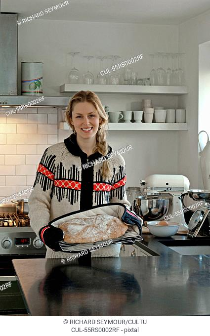 Woman with freshly baked bread